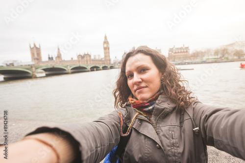 Beautiful woman taking a selfie in London - 81426708