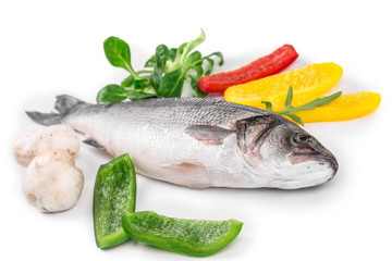 Fresh seabass with lemon and tomato on plate.