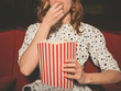 Woman eating popcorn and watching movie - 81427146
