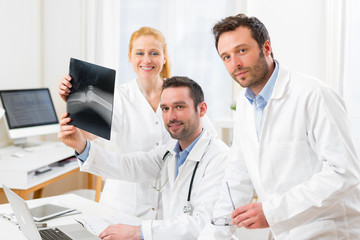 Medical team analysing together a x ray at the hospital