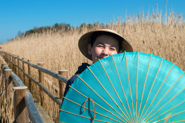Boy with chinese umbrella