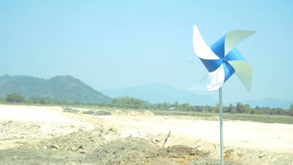 Colorful wind turbine rotating blowing of wind, dried landscape