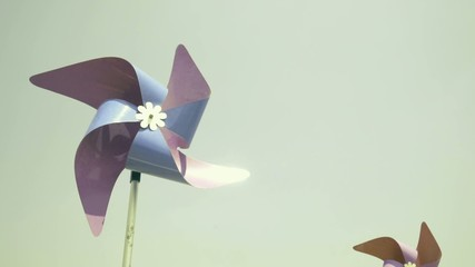 Colorful wind turbine rotating by blowing of wind, vintage look