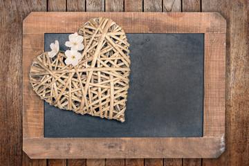 Wooden heart and vintage wooden blackboard
