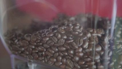 Fresh coffee beans in coffee machine