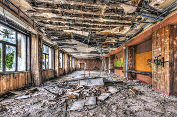 Dilapidated function room in an abandoned hotel