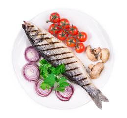 Grilled seabass on plate with tomatoes.