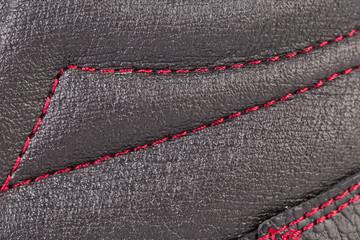 Close up of red stitch.