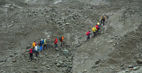 Group of  hikers on the immense Kennicott glacier