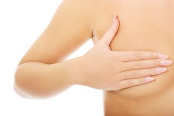 Woman examining breast.