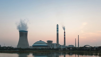 industrial landscape, time lapse of power plant in sunset