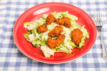 Buffalo Chicken Nuggets on Caesar Salad