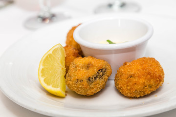 Conch Fritters with Lemon and Sauce.jpg