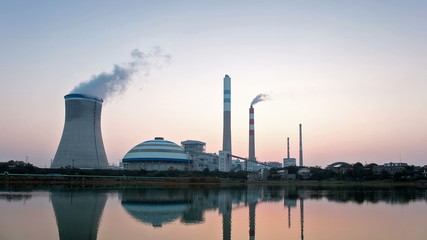time lapse of power plant in sunset , industrial landscape