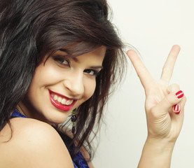 young woman showing two fingers