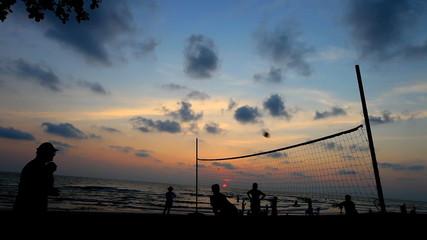 people enjoy play volleyball on twilight beach