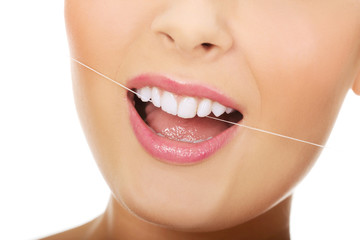 Woman with dental floss.