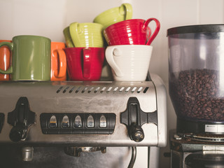 Coffee machine and colorful cups