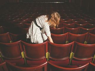 Woman taking her seat in auditorium
