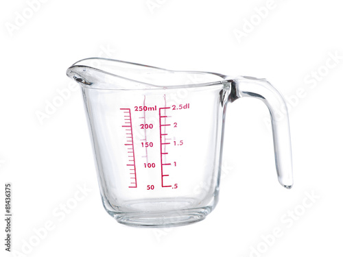 Glass mesuring cup close-up on white background - 81436375