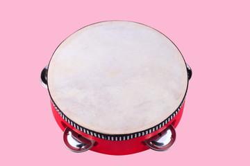 tambourine isolated on pink