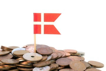 Close up of danish flag planted in coins on white background