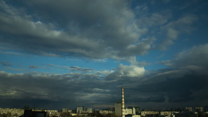 The industrial city landscape with thunderstorm clouds