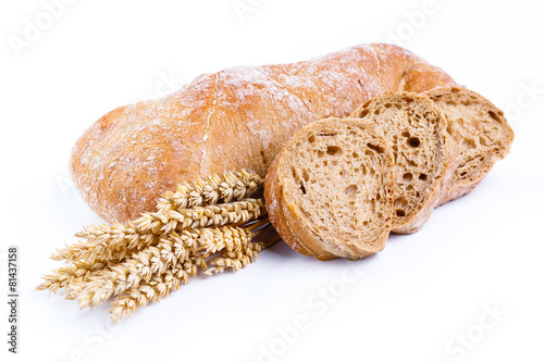 Tasty bread with wheat on a white background. - 81437158