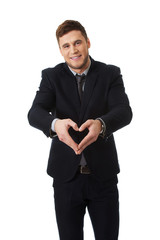 Man is showing a love sign by his hands.