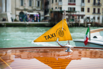 Taxi boat on Canal Grande with Venezia .