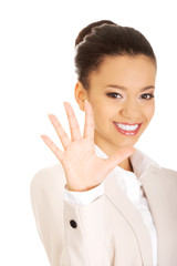 Businesswoman gesturing five in hand.