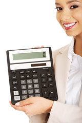 Smiling business woman with a calculator.