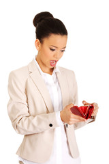 Shocked businesswoman with wallet.