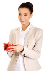 Happy businesswoman with wallet.