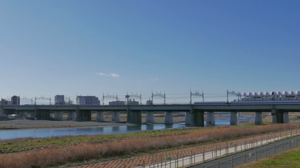 Tokyo rural train on the bridge over Tamagawa river.