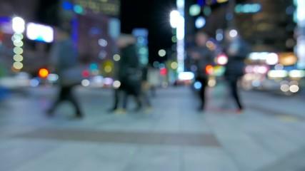 Anonymous crowd of people walking in Sukiyabashi crossing,Tokyo.