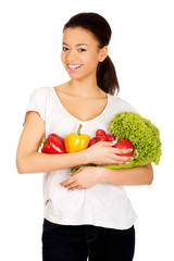 Young woman with vegetables.