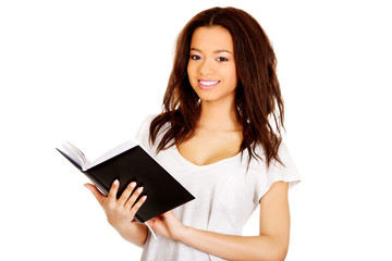 Young student woman with notebook.