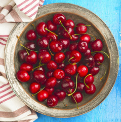 Red cherry on a silver plate