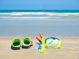 norkeling equipment on sand beach