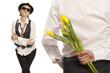 Man hiding bouquet flowers