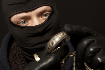 Thief with a silver bracelet