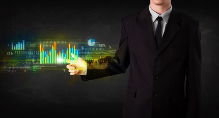 Young business person touching colorful charts and diagrams