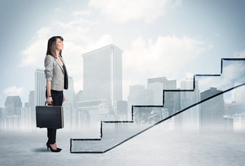 Business person in front of a staircase