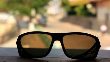 sunglasses on the city background