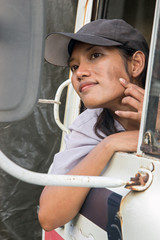 A woman driver watching her face in the mirror