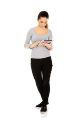 Casual woman with tablet.