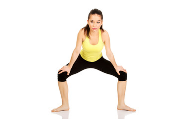 Young woman in warm up exercise.