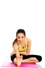 Fitness woman doing stretching exercise.