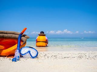 dive equipment on white sand beach